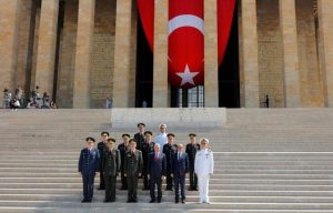 Turkey's Prime Minister Binali Yildirim (3rd R), Chief of Staff General Hulusi Akar (3rd L), Defense Minister Fikri Isik (2nd R) and the country's top generals pose in Anitkabir, the mausoleum of modern Turkey's founder Mustafa Kemal Ataturk, after a wreath-laying ceremony ahead of a High Military Council meeting in Ankara, Turkey, July 28, 2016. REUTERS/Umit Bektas