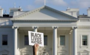 A demonstrator with Black Lives Matter holds up a sign during a protest in front of the White House in Washington, U.S., July 8, 2016. REUTERS/Joshua Roberts