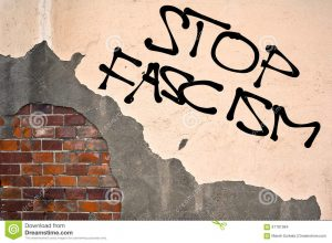 stop-fascism-text-sprayed-old-wall-anarchist-aesthetics-67781084
