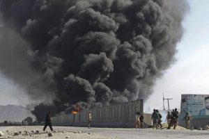 Smoke billows from a fuel tank supplying NATO troops, after it was set on fire by protesters during a demonstration in Jalalabad province February 22, 2012. Gunfire wounded at least 26 people during fresh protests in several cities across Afghanistan over the burning of copies of the Koran, Islam's holy book, at NATO's main base in Afghanistan. REUTERS/Parwiz (AFGHANISTAN - Tags: CIVIL UNREST RELIGION TPX IMAGES OF THE DAY)