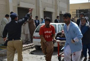 Pakistani volunteers rush an injured person for medical help following a bomb blast in Quetta, Pakistan, Monday, Aug. 8, 2016. A powerful bomb went off inside a government-run hospital in the southwestern city of Quetta on Monday, killing dozens of people and wounding dozens of others, police said. (AP Photo/Arshad Butt)